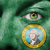 Flag Painted On Face With Green Eye To Show Washington Support