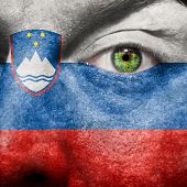 Slovenian Flag Painted On A Man's Face
