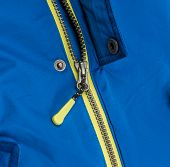 Close up zipper on a blue background