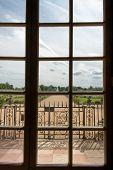 Framed window view toward the Hampton Court Palace gardens