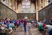 HAMPTON COURT, UK - AUGUST 03, 2014 - The Tudor Great Hall at Hampton Court Palace with group of tou