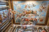HAMPTON COURT, UK - AUGUST 03, 2014 - Ceiling painting showing Christian images inside Hampton Court