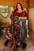 MUSKOGEE, OK - MAY 24: Ladies make yarn on spinning wheels at the Oklahoma 19th annual Renaissance F