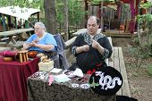 MUSKOGEE, OK - MAY 24: A man shows off craft of lace making at the Oklahoma 19th annual Renaissance