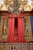 HAMPTON COURT, UK - AUGUST 03, 2014 - Baroque bed at state bedchamber at Hampton Court Palace near L
