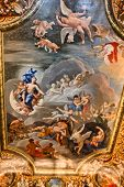 HAMPTON COURT, UK - AUGUST 03, 2014 - Ceiling painting showing Christian images inside Hampton Court