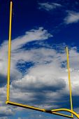 Goal Posts Agains Cloudy Blue Sky