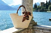 Basket bag against lake Como, Italy