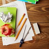 school office supplies on wooden desk