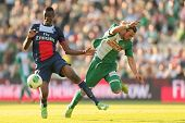 VIENNA, AUSTRIA - JULY 12 Harald Pichler (#27 Rapid) and Kalifa Coulibaly (#37 Paris) fight for the