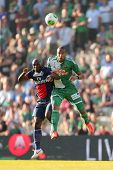VIENNA, AUSTRIA - JULY 12 Terrence Boyd (#9 Rapid) and Zoumana Camara (#6 Paris) fight for the ball