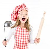 Screaming Little Girl In Chef Hat With Ladle And  Rolling Pin