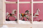 Indoor Window Sill Christmas Decoration: Rocking Horses And Snow; Checkered Background