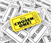 The Chosen One words on a golden ticket on a pile of other tickets as winner or lucky chosen candidate