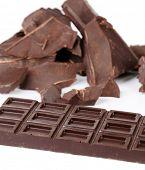 Cracked chocolate bar isolated on white