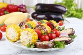 Sliced vegetables on picks on plate on table close-up
