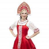 Smile young woman hands on hips portrait  in russian traditional costume