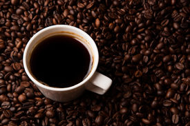 picture of peppy  - cup of black coffee and roasted coffe beans background - JPG