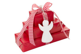 stock photo of christmas angel  - Red christmas presents with a white wooden angel an red checkered ribbon isolated in Country style - JPG