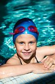 Child - Swimmer Swims In A Swimming Pool