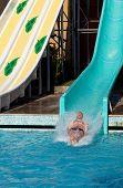 Man riding a water slide