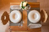 Table Set In Mountain Chalet For Two People