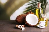 picture of coco  - Coconuts and coconut oil on wooden table - JPG