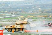 Tank T-90S moves after water ford