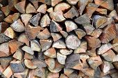 stock photo of split ends  - Pile of douglas fir firewood viewed end on - JPG