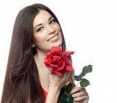 closeup portrait of attractive  caucasian smiling woman brunette isolated on white studio shot lips toothy smile face hair head and shoulders looking at camera tooth red rose flower figure body