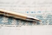 picture of debenture  - Close up of pen on ten shares - JPG