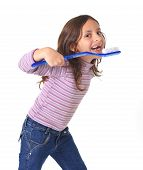 Sweet Cute Young Girl Gap Toothed With Huge Toothbrush Cleaning Her Mouth In Dental Care Concept
