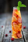 Fresh Fruit Detox Water In Bottle On Wooden Table
