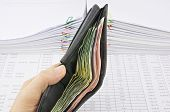 Man Holding Wallet Full Of Bills