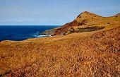 Dry Landscape Over Blue Ocean