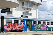 An Italian Train adorned with urban art.