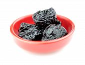 Prunes Pitted And Dehydrated Isolated On White Background In Bowl