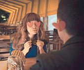 Loving Couple At Restaurant