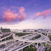 skyline and traffic trails on highway intersection