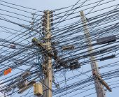 foto of utility pole  - image of busy line on electric pole - JPG