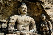 picture of grotto  - Huge Bodhisattva in a huge cave in Yunmen grotto in China - JPG