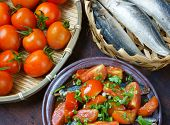 stock photo of raw materials  - Vietnamese food braised fish with tomato a popular dish in Vietnam meal cheap tasty nutrition and fresh raw material fish stew with fish sauce sugar season with tomato spice - JPG