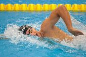 GRAZ, AUSTRIA - APRIL 04, 2014: Gergely Gyurta (Hungary) wins the men's 800m freestyle event in an indoor swimming meeting.