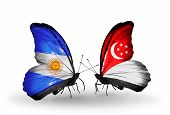 Two Butterflies With Flags On Wings As Symbol Of Relations Argentina And Singapore