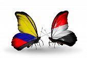 Two Butterflies With Flags On Wings As Symbol Of Relations Columbia And Yemen
