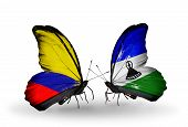 Two Butterflies With Flags On Wings As Symbol Of Relations Columbia And Lesotho