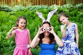 Funny Mother With Children Wearing Bunny Ears And Silly Eyes