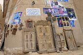 Wall of the souvenir shop with political posters, Shibam, Yemen.
