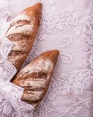 picture of baguette  - rye baguettes on a white lacy napkin breakfast - JPG