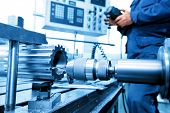 foto of boring  - Man operating CNC drilling and boring machine in workshop - JPG